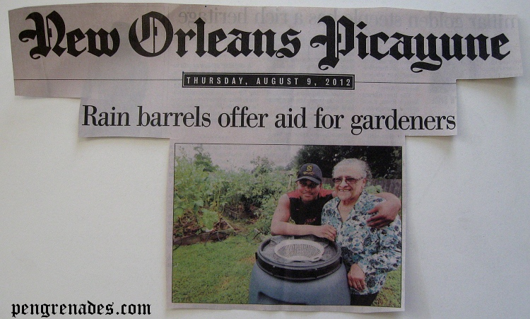 newspaper clipping about rain barrels