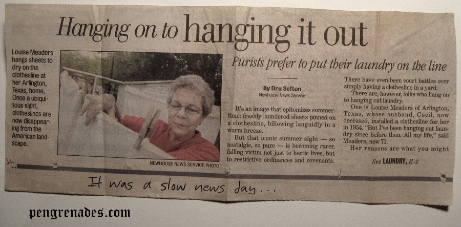 newspaper clipping of an elderly woman hanging her laundry