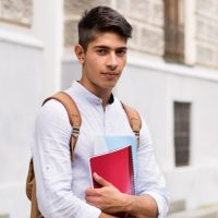 teenage-student-in-front-of-old-building-picture-id846419176