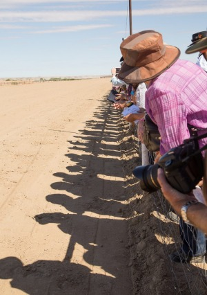 The crowds await the horses on the final straight at the Betoota Race Track. photo: Lorraine Kath
