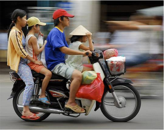 Minimum number of people allowed on a Ho Chi Minh scooter. Photo: Growers and Nomads.