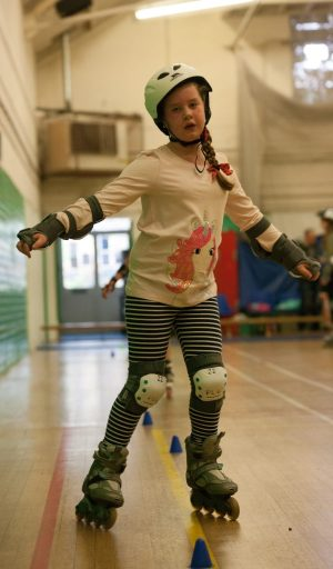 Girl skating between cones