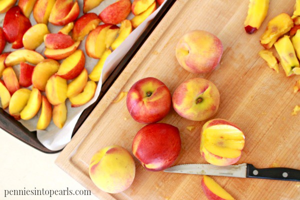 Freezing Fruit for Smoothies - penniesintopearls.com - Learn how to save money by freezing fruit on your own. Simple steps to freezing fruit and helping make smoothies easy!