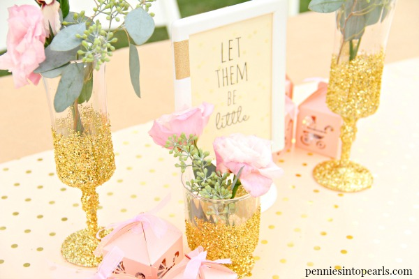 I love all the tips this girl shares on how to throw a fabulous party on a budget! You would never guess that these glitter obmre flower vases were all made with supplies from the dollar store! LOVE these ideas for dollar tree party décor!