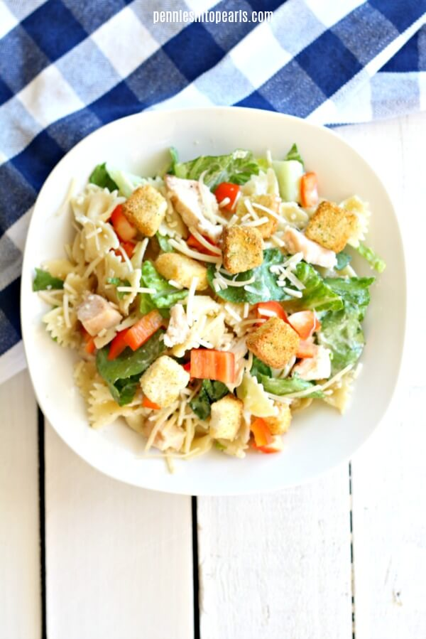 What mom isn't all about easy dinner ideas that their entire family will happily eat? Exactly! All moms need a quick, easy, and cheap dinner. Which is why you need this Easy Cesar Pasta Salad Recipe in your monthly meal plan!
