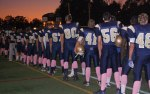 football players sported pink socks