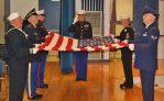 folding and saluting the flag