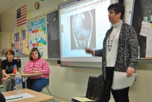 Kerry Graver speaks to the class as Emily watches