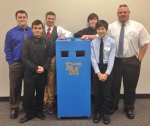 Students pose with their portable food bank and teacher Barry Groff, far right. The students are, from left, Christopher Stillwell, Alexander Thomas, Mitch Haag, Jack Whalen and Kevin Ward.