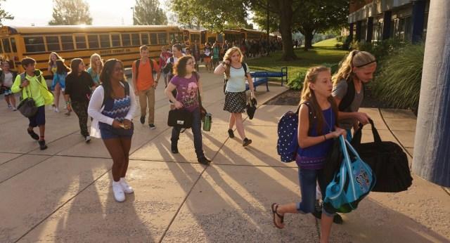 Kids entering school building
