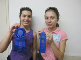 Sebrianne and Dina Ferguson of Redwood City show off the awards the girls earned from entering their stamp exhibits at the 2011 Santa Clara County Fair.