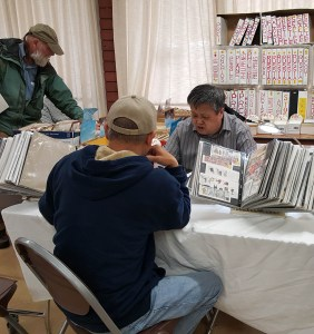 Stamp collectors meet stamp dealers