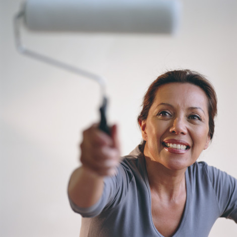 Woman Painting with a Paint Roller