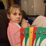 My daughter holding her winning uno hand