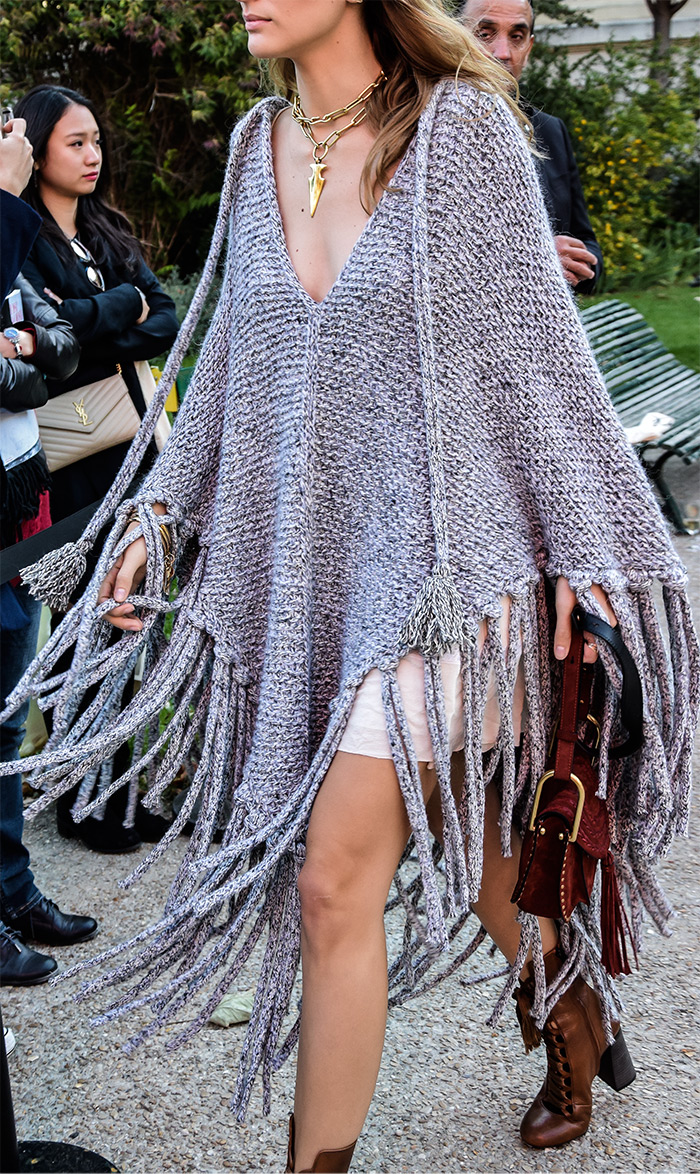 How to wear woven poncho, Sofia Sanchez de Batek wearing grey woven poncho, Paris Fashion Week street style fashion by PeopleandStyles.com