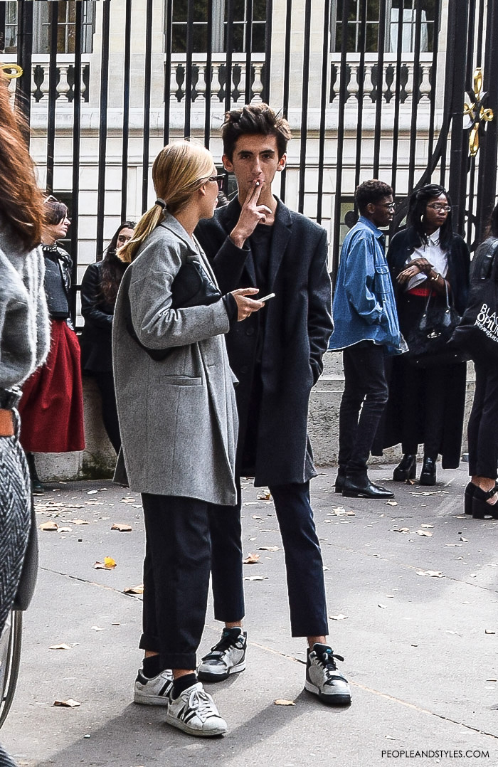 What urban couples are wearing, what are people wearing in paris? street style Paris, male black grey clothing style white sneakers outfit men's style fashion images Pinterest
