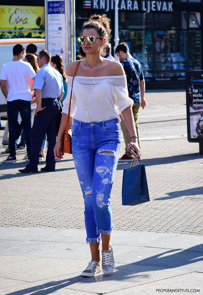 Street style summer women's fashion, how to wear off the shoulder white top, trendy mirror sunglasses, and distressed jeans