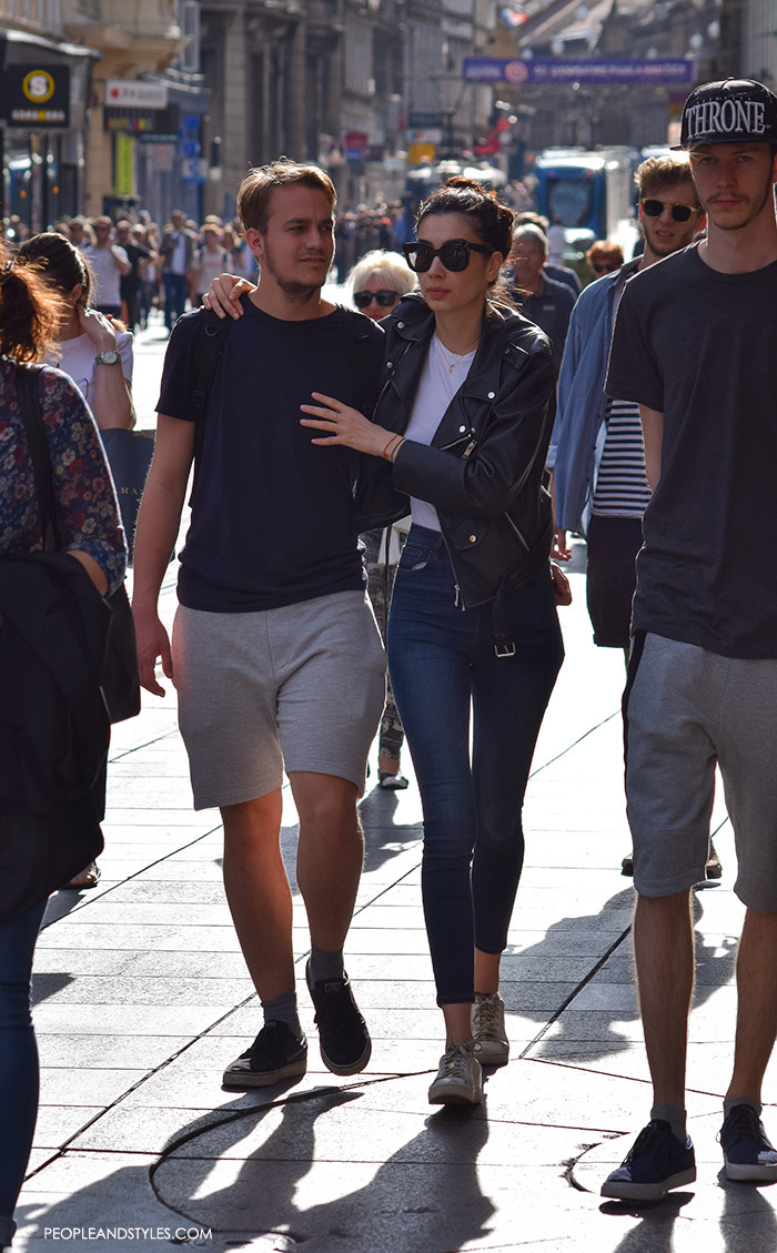 Street style summer 2016, couples street fashion, mens's fashion joggers shorts and a tee, on her: skinny high waist jeasn and biker jacket