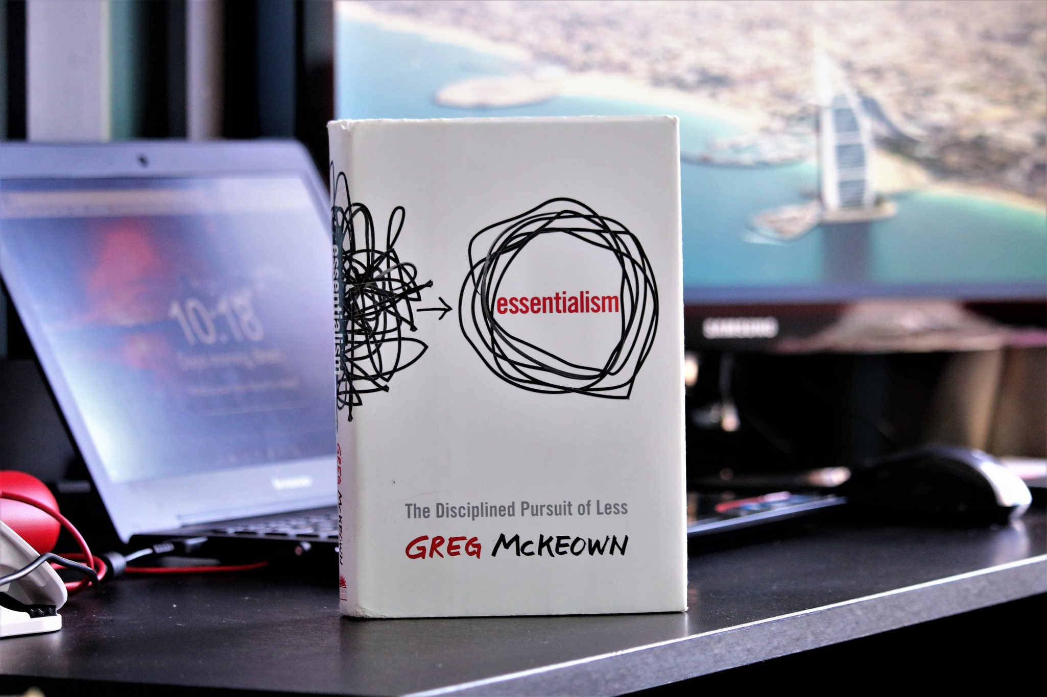 Greg McKeown's Essentialism on a desk in a home office