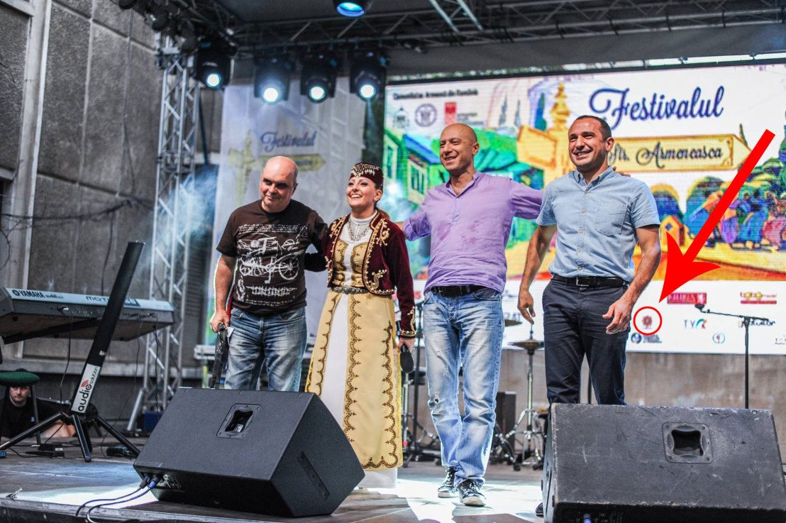 PeopleOfAr logo on screen on the stage of the Armenian Street Festival in Romania