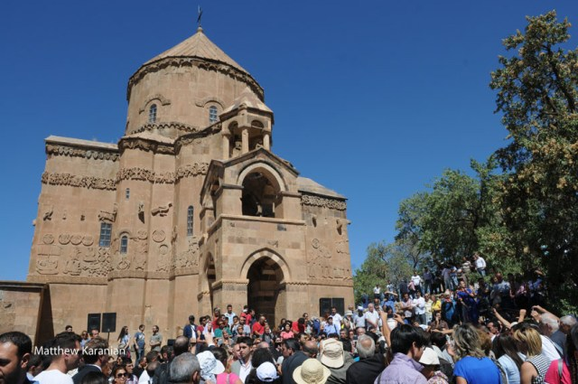 A crowd of pilgrims gathers outside the Church of the Holy Cross at Aghtamar, following the first baptism at the church since 1915. (Photo by Matthew Karanian)