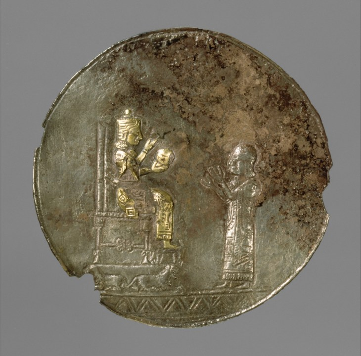 Armenian Medallion with a seated deity and a male worshiper, Iron Age ca. 8th–7th century B.C. Urartu (Ararat) period. Silver, gold foil - Gift of Norbert Schimmel Trust, 1989