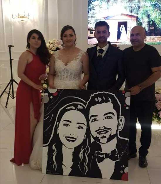 consegna ritratto sposi al matrimonio