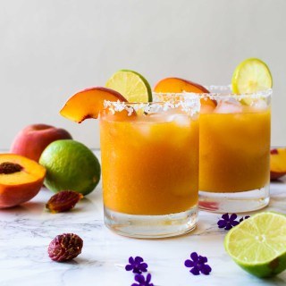 Peach Margarita- Pepper Delight #pepperdelightblog #recipe #margarita #peach #drinks #cocktails #cincodemayo #mexican #summerdrinks #summerishere #summercocktails #peachdrinks