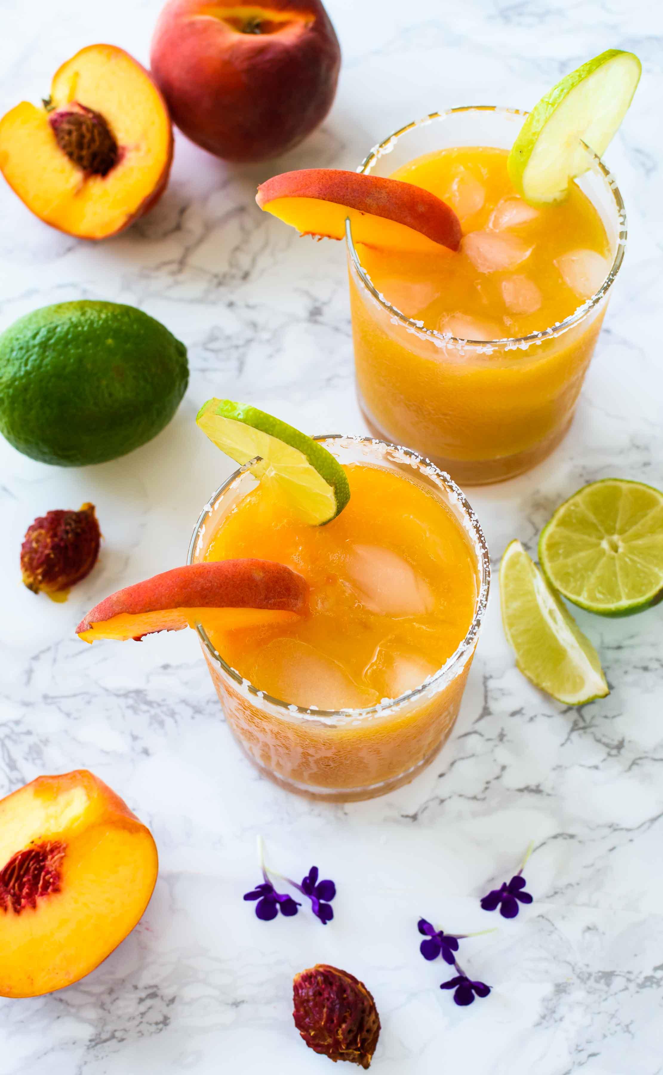 Peach Margarita- Pepper Delight #pepperdelightblog #recipe #margarita #peach #drinks #cocktails #cincodemayo #mexican #summerdrinks #summerishere #summercocktails #peachdrinks