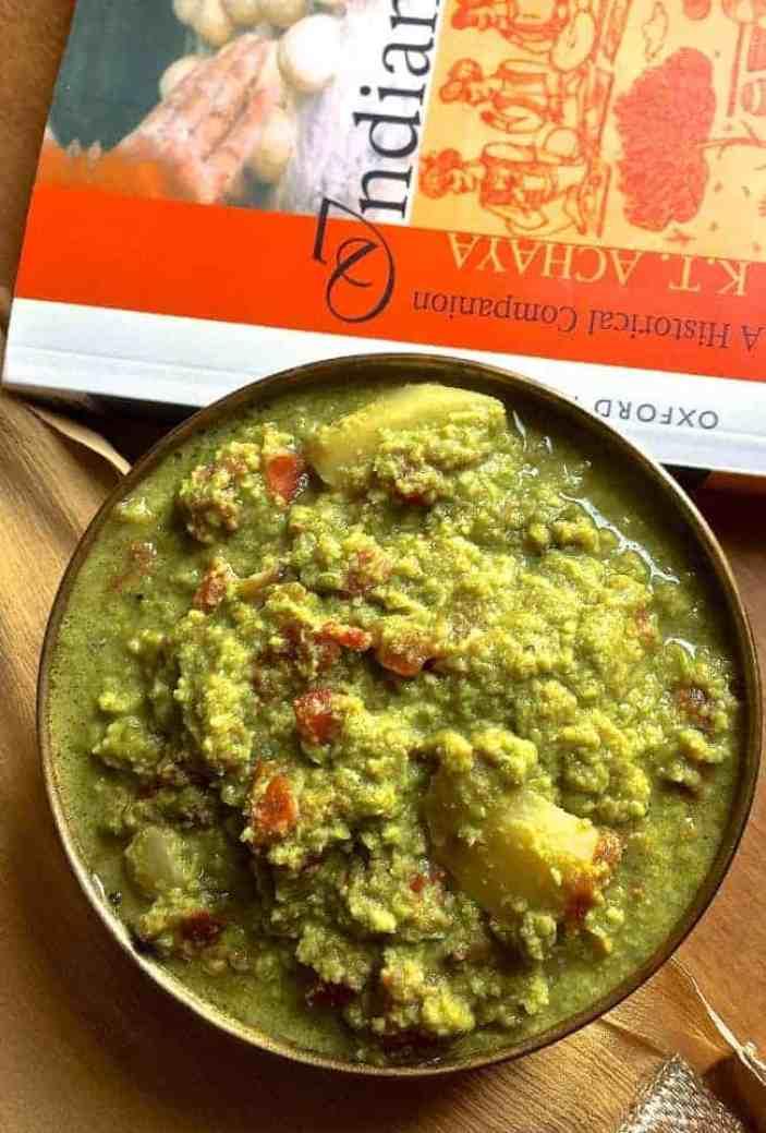 Nimona, a dish from Eastern UP in India, made from fresh pureed green peas. Seen here in a brass bowl and a red book alongside, the curry is served usually with rice