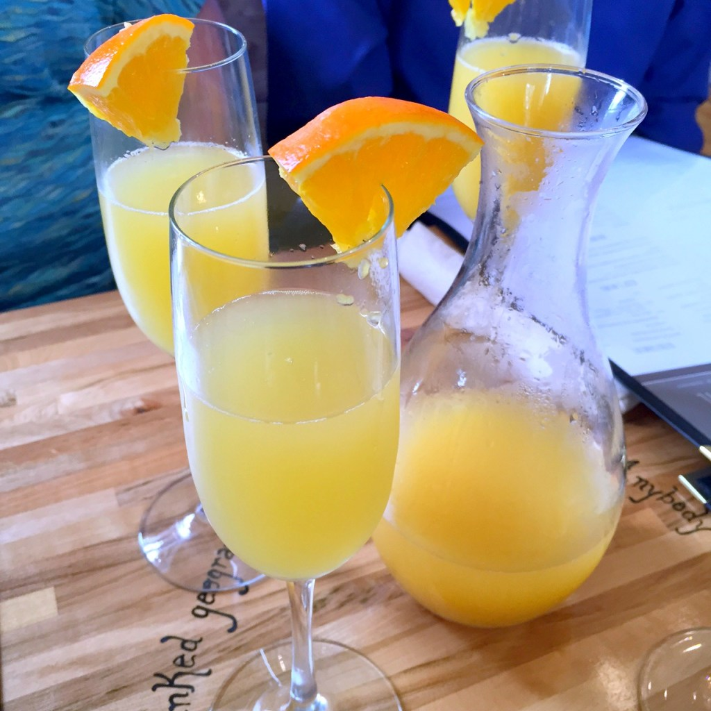 Mimosas with fresh oranges!