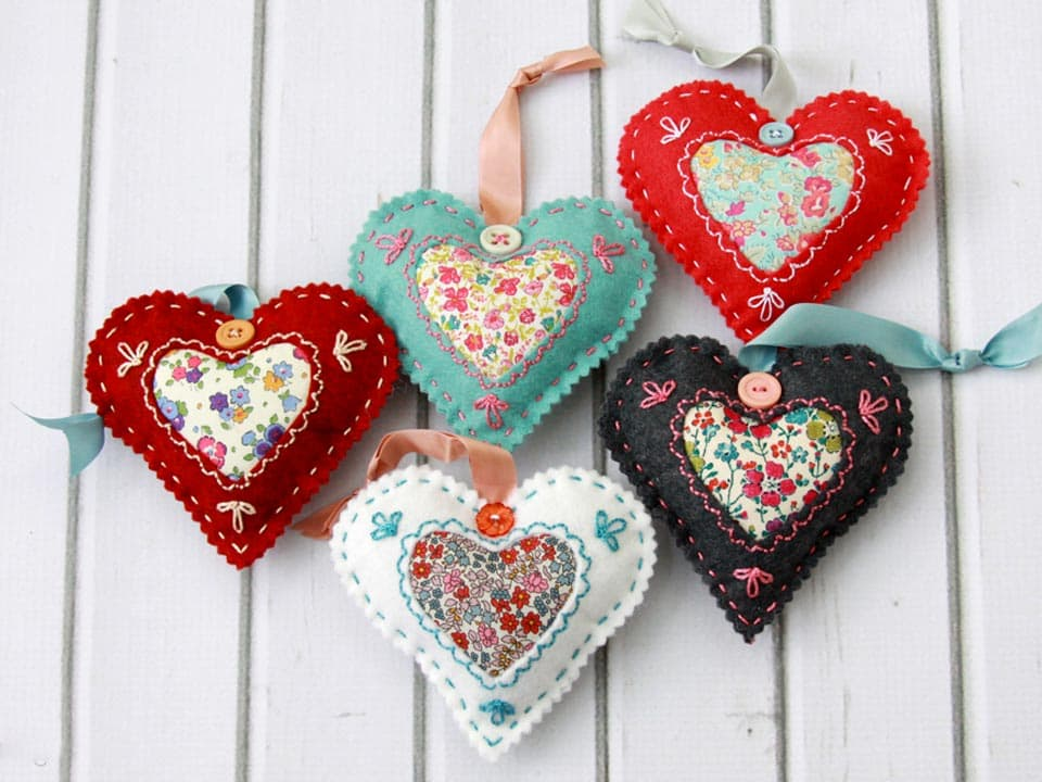 Valentines day crafts, fabric and felt stuffed heart shapes on ribbons