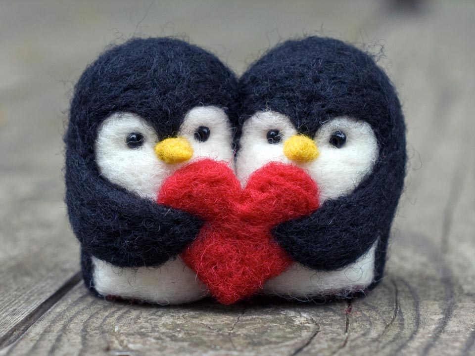 Two little needle crafted penguins holding a red heart together, Valentines Craft Gift