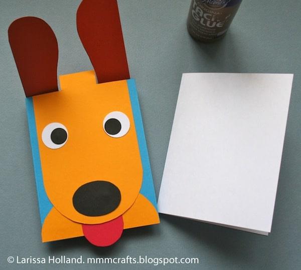 una tarjeta con la cara de un perrito