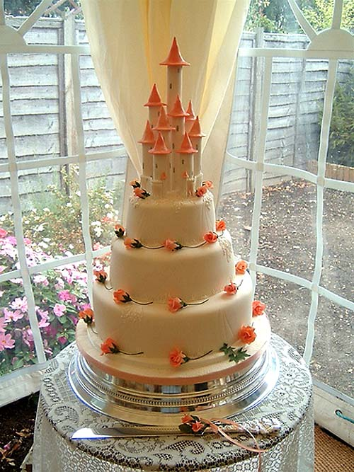 Castle Wedding Cakes for the Princess Bride Huge three tier cream and orange wedding cake castle
