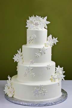 Festive Christmas Wedding Cakes Gallery Simple four tier  winter white Christmas snowflake wedding cake is  decorated with large snow white