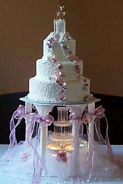 Water Fountain Wedding Cakes Gallery Three tier pink and white castle wedding cake raised up on 5 pillars to  allow a