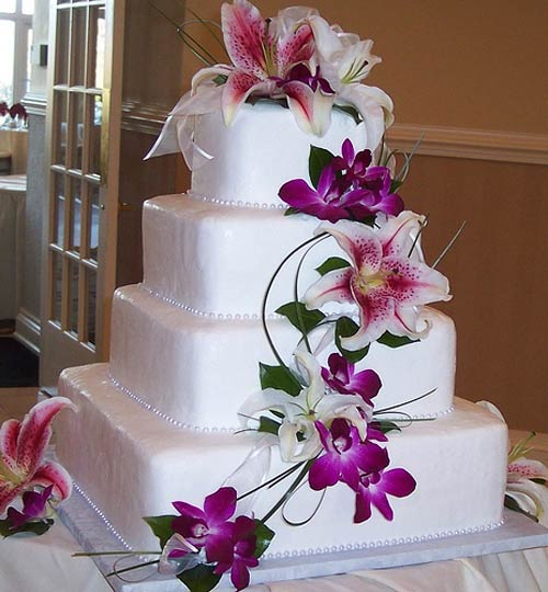 Tropical Hawaiian Theme Cake Designs Square four tier white fondant wedding cake decorated with tropical  flowers  like purple orchids