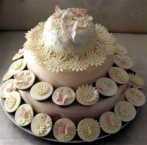 Delicious Wedding Cupcakes  Pictures   Ideas Two tier romantic style ivory cupcake tiered wedding cake