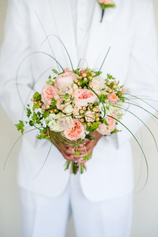 bouquet of garden roses protea hypericum berries white stock