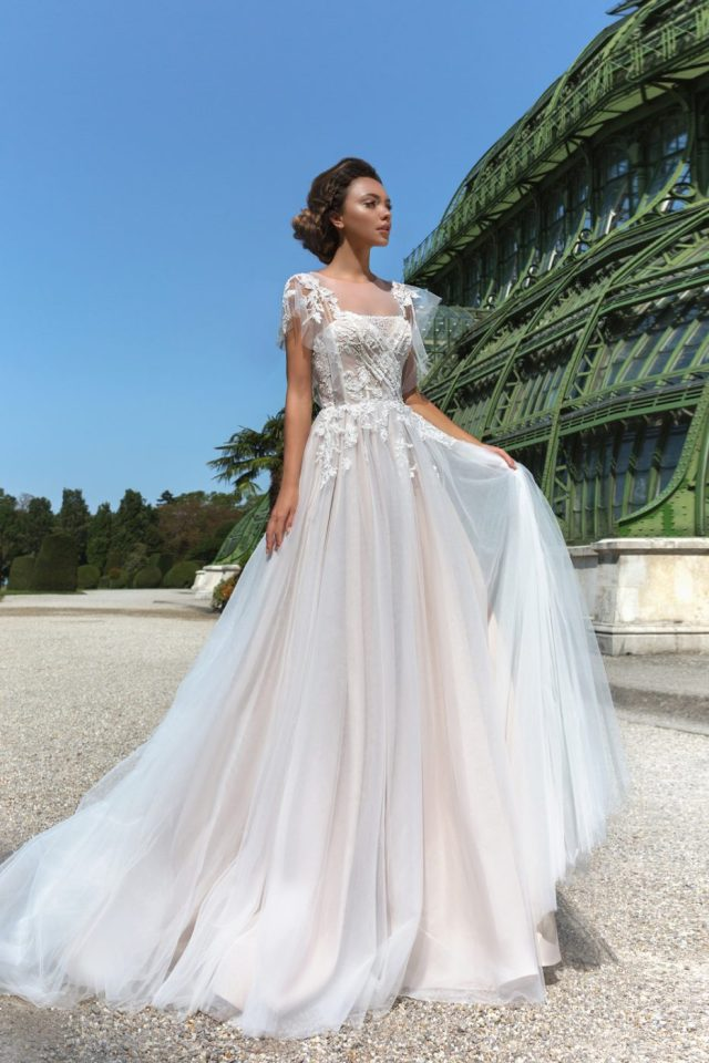illusion flutter sleeve wedding dress by Crystal Design Couture