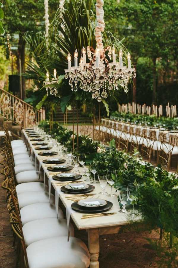 outdoorhanging chandelier and greenery decor