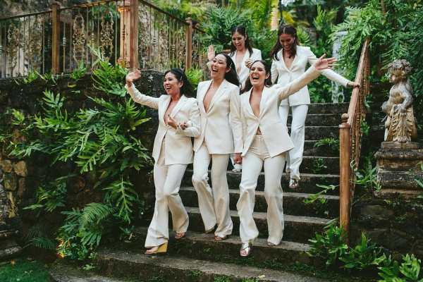 bridesmaids in white suits
