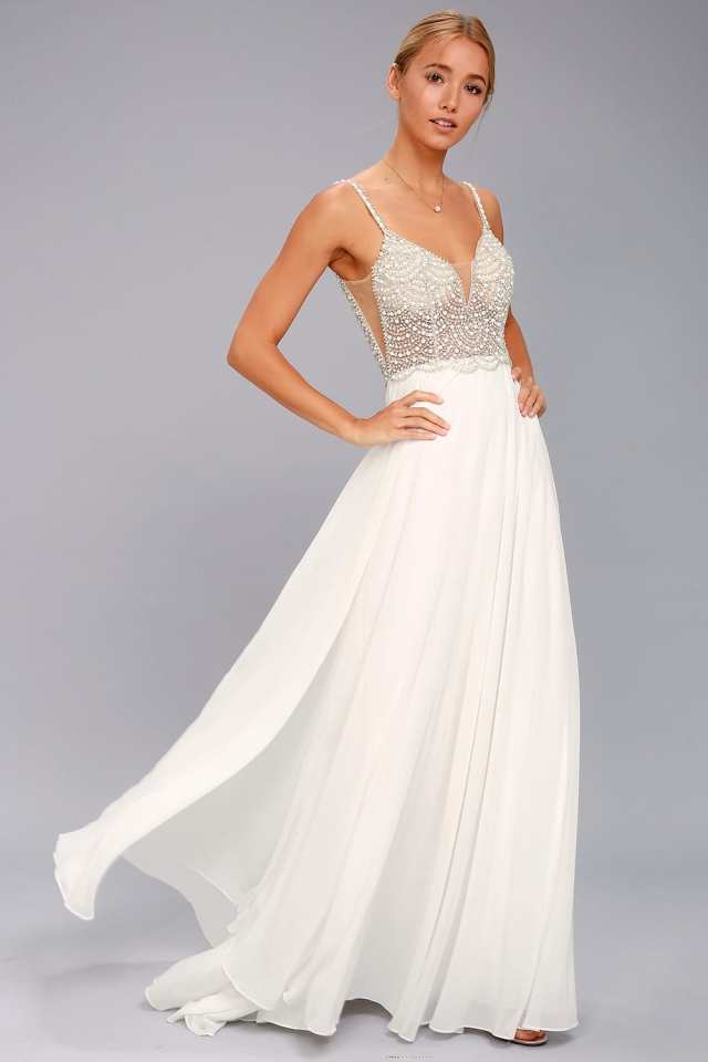 Embellished evening gown with illusion bodice. beaded. romantic.