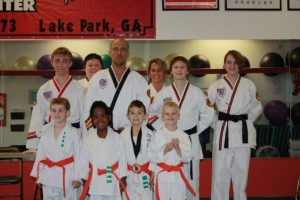 Instructor Mitchell Church, proudly stands with Lake Parks first Graduating Group of Tiny Tigers