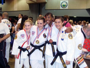 Ms. Britney Johnson (Center) and the other Top Sparring girls in the 2nd Degree, Girls 11-12-13