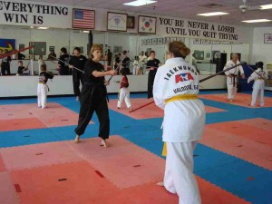 World Champion Jennifer Powell and the other Instructors, each help individual leadership students with their bo-staff techniques.