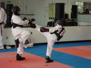 Junior Leadership Sparring Practice - Young students practice their sparring skills under Mr. Church's tutelage.