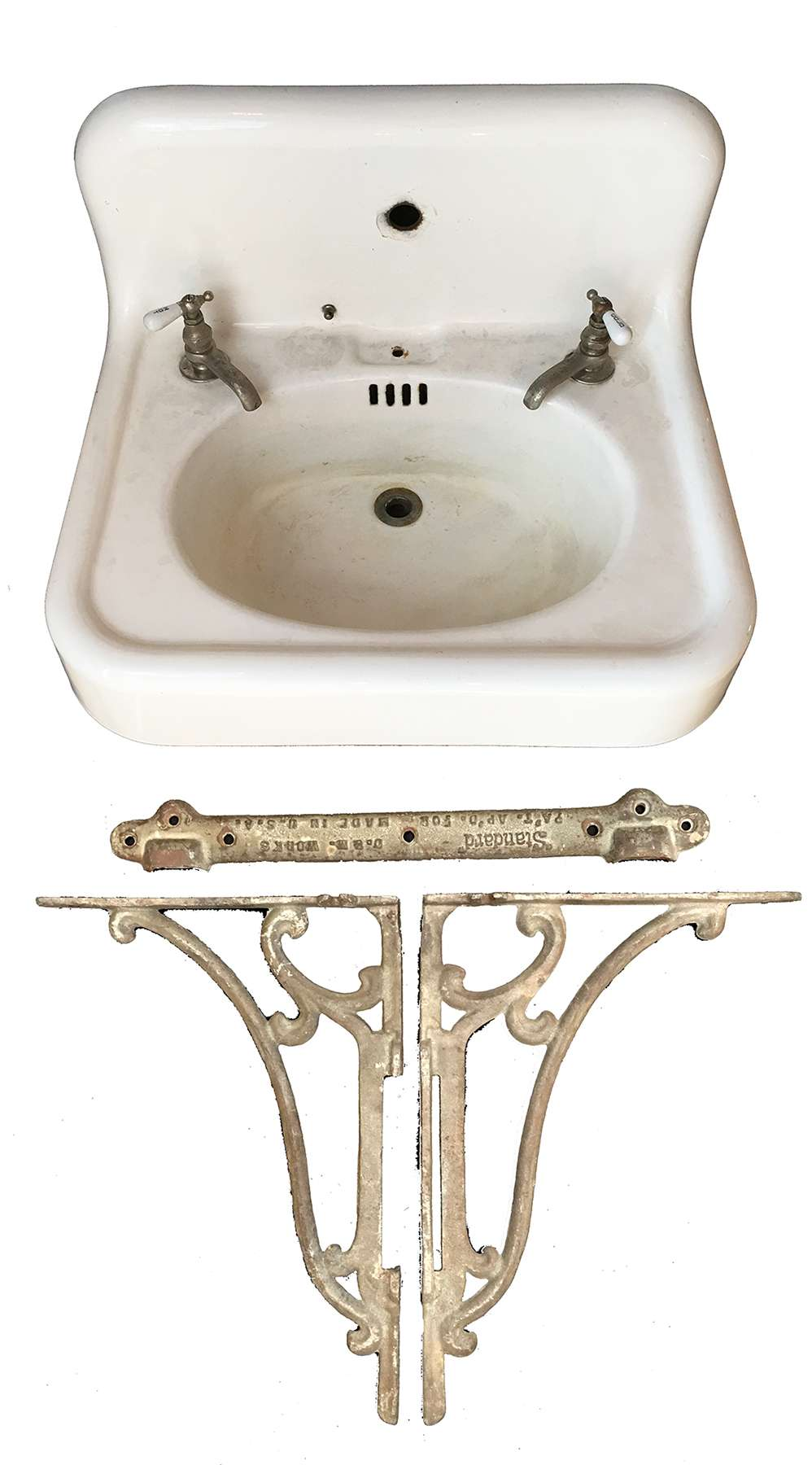 antique american standard wall hung sink with decorative brackets and high backsplash
