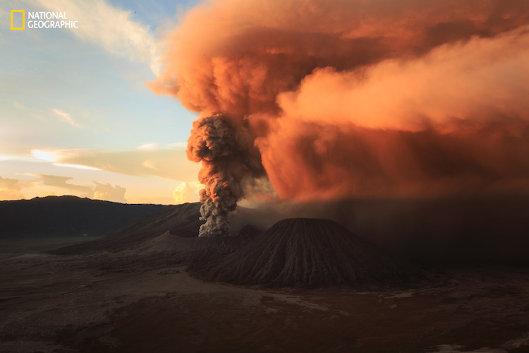 A scene of sunrise rays which is reflected on an intense smoke of Bromo eruption.